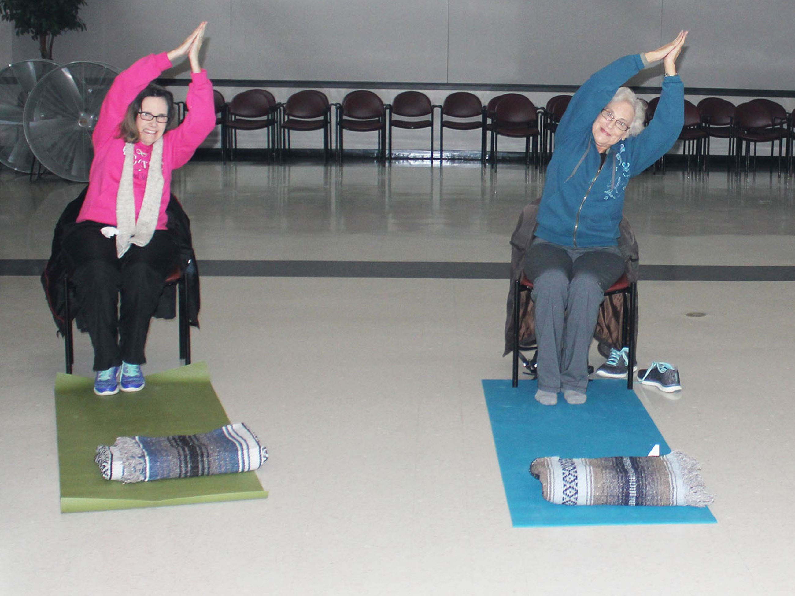 Two ladies participating in Chair Yoga